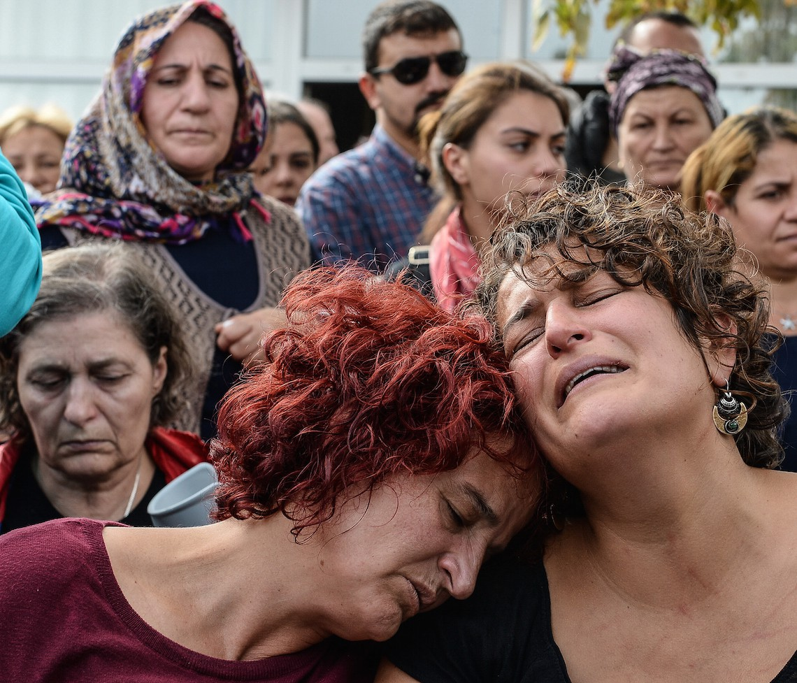 ANKARA, TURKEY - OCTOBER 11: Family members of Korkmaz Tedik, a victim of Saturday's bomb blasts, react as they mourn during a funeral ceremony in Ankara, October 11, 2015 Turkey. Thousands of people, many chanting anti-government slogans, gathered in central Ankara on Sunday near the scene of bomb blasts which killed at least 95 people, mourning the victims of the most deadly attack of its kind on Turkish soil. Police insisted investigators were still working at the site. Turkish PM Davutoglu declares three days of national mourning over Ankara bomb attacks. (Photo by Gokhan Tan/Getty Images)