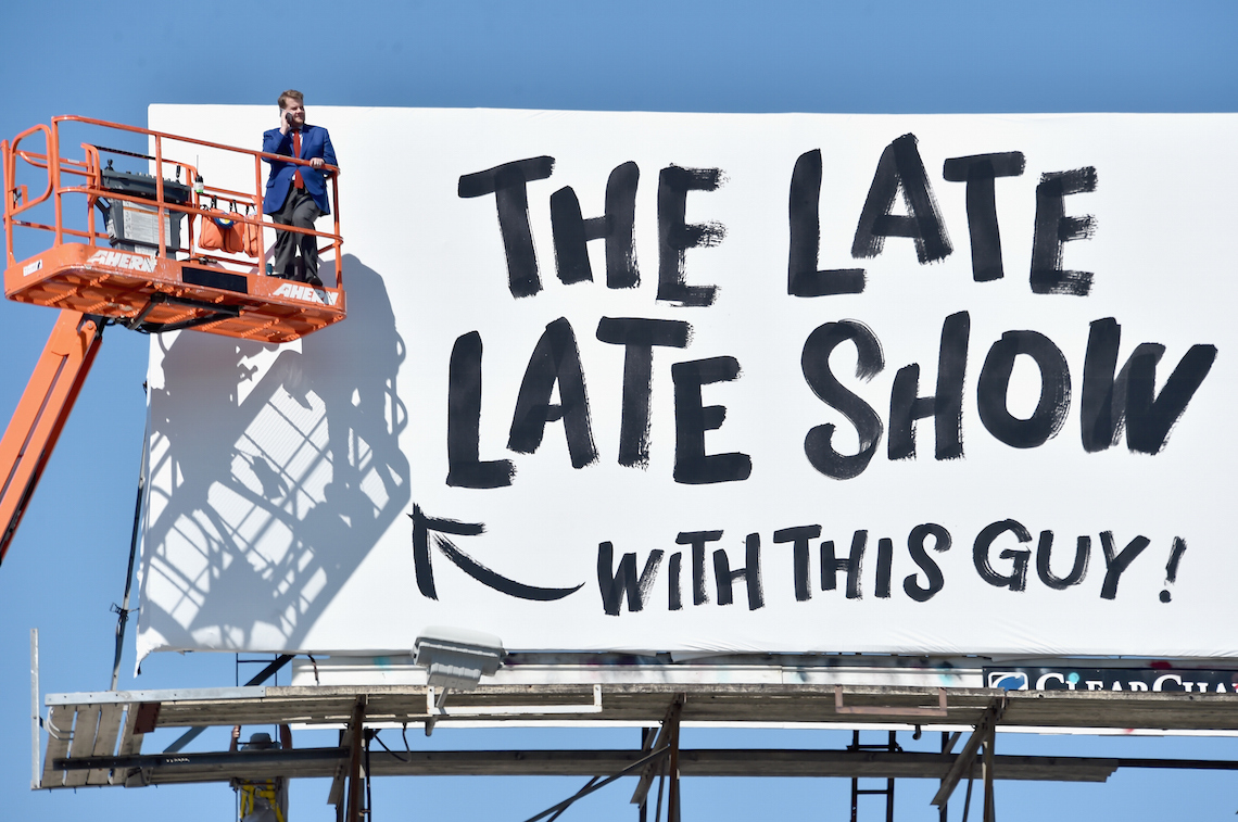"LOS ANGELES, CA - MARCH 06: Actor/host James Corden puts up his own billboard for CBS Television Network's ""The Late Late Show"" on March 6, 2015 in Los Angeles, California. (Photo by Alberto E. Rodriguez/Getty Images)"