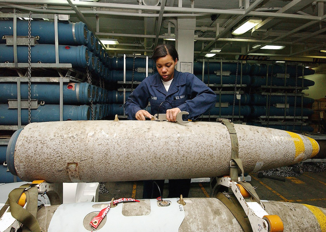 040429-N-1082Z-116  Arabian Gulf (April 29, 2004) ñ Aviation Ordnanceman Airman Lauren Carr of Atlanta, puts a switch on a 2,000 lb. MK-84 general-purpose bomb in a weapons magazine aboard USS George Washington (CVN 73).  The Norfolk, Va.ñ based nuclear powered aircraft carrier is on a scheduled deployment in support of Operation Iraqi Freedom (OIF). Official U. S. Navy photo by Photographerís Mate Airman Jason R. Zalasky.