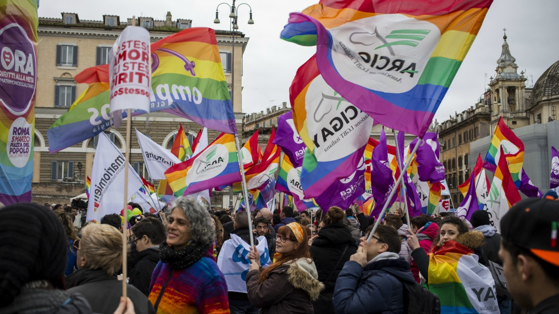PIAZZA DEL POPOLO, ROME, LAZIO, ITALY - 2016/03/05: Protesters wave flags during a protest. Thousands of people  gather in Piazza Del Popolo to show their solidarity for the recognition of LGBT rights. Associations and groups have expressed their disappointment about the changes that the government has made to the bill Cirinnà which precisely guarantees to gay couples all rights and equal duty as heterosexual couples, including the right to adopt stepson. (Photo by Davide Bosco/Pacific Press/LightRocket via Getty Images)