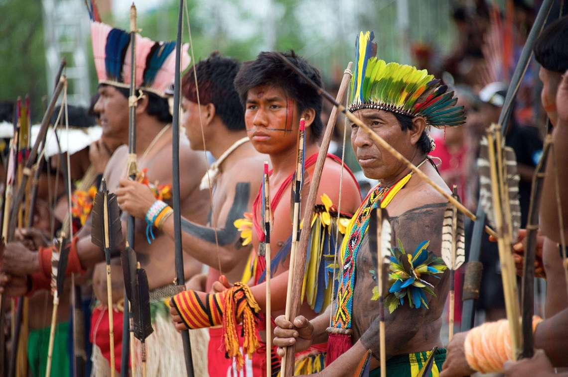 Indigenous men of various tribes wait to take part in the bow and arrow competition during the XII International Games of Indigenous Peoples in Cuiaba, Mato Grosso state, Brazil on November 12, 2013. 1500 natives from 49 Brazilian ethnic groups and from another 17 countries are gathering in Cuiaba until November 16 to compete in some 30 athletic disciplines, many of their own. (Christophe Simon/Getty Images)