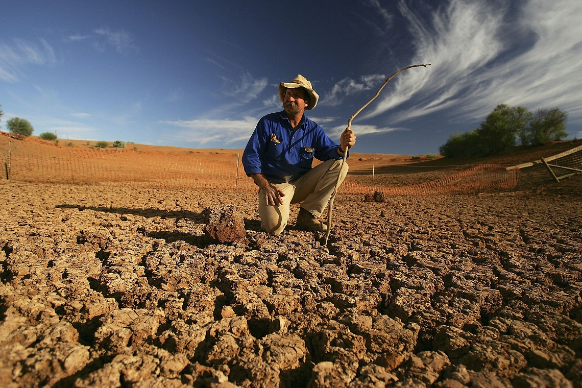 LEIGH CREEK, AUSTRALIA - JUNE 7:  Stockman Gordon Litchfield from Wilpoorinna sheep and cattle station surveys the bottom of a dry dam on his property on June 7, 2005 in Leigh Creek, Australia. Australia is enduring its worst drought in decades and with the combined affect of increasing temperatures and the El Nino weather phenomenon there appears no sign of abatement.  (Photo by Ian Waldie/Getty Images)
