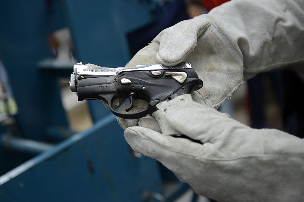 A seized pistol rendered useless during a weapon destruction operation is shown in Caracas on May 20, 2013. AFP PHOTO/Leo RAMIREZ        (Photo credit should read LEO RAMIREZ/AFP/Getty Images)